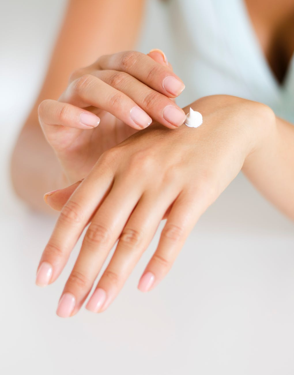 applying body lotion care cosmetic product